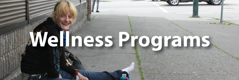 Wellness Programs button showing lay siting on street smiling